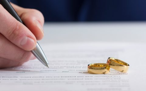 signing-divorce-paper-rings